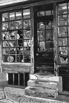 ANTIQUE SHOP, RYE - Peeling paintwork (before it was repainted!) round the windows of an antique shop in the Strand at the bottom of Mermaid Street in Rye Limited edition etching