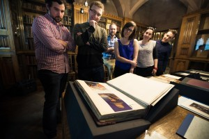 Some BrANCA members viewing the collections Image courtesy of the School of Arts, Languages & Cultures, University of Manchester