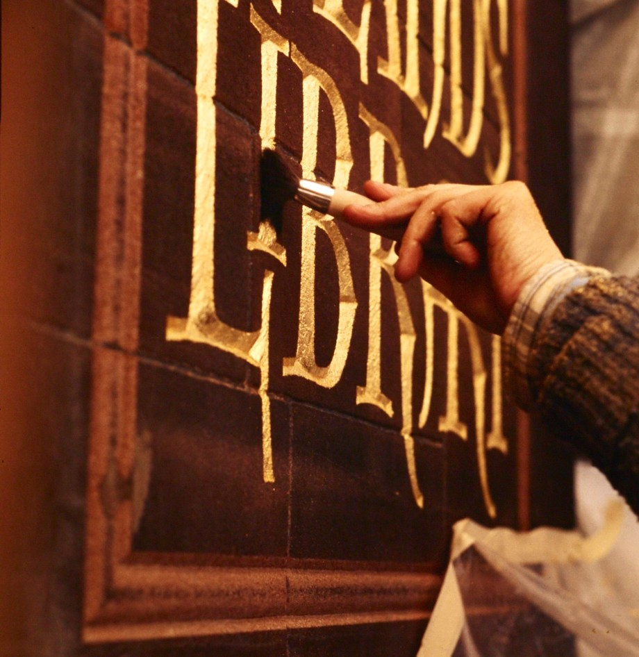 Gilding a carved panel