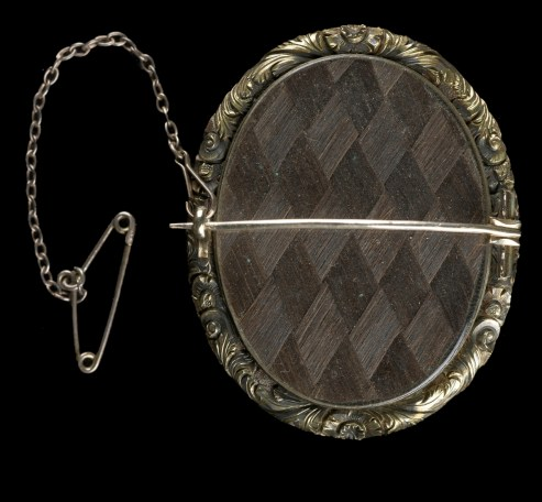 Photographic brooch, containing hairwork.