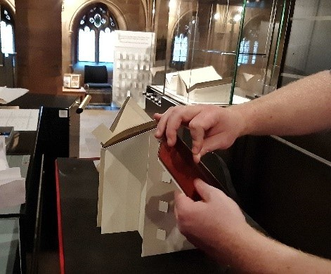 Strapping the book on a machine made cradle