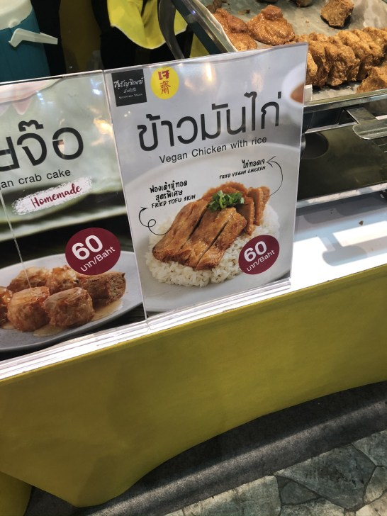 Picture of vegan 'chicken' and rice price board