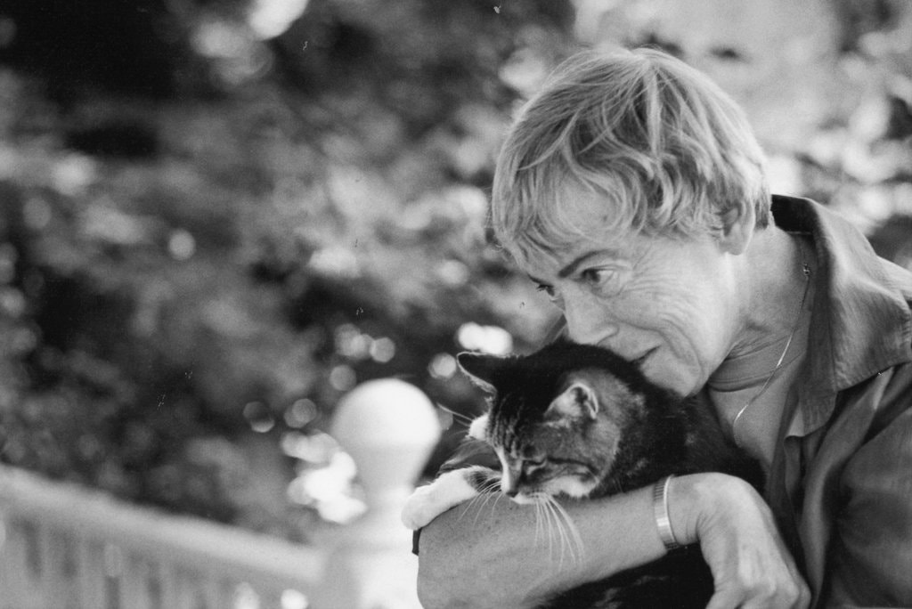 Photo of Ursula Le Guin, author of The Dispossessed, in black and white holding a cat