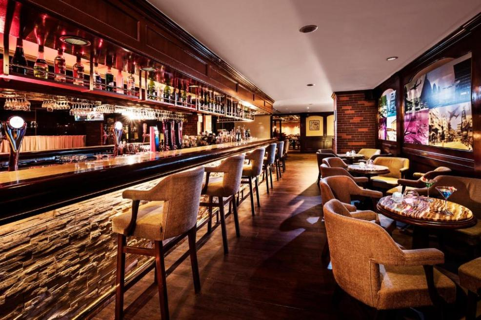 The lounge or bar area at Regal Oriental Hotel