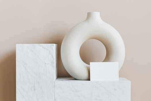 decorative vase of ring shape with blank card on marble stand