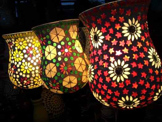 three assorted color floral projection lamps