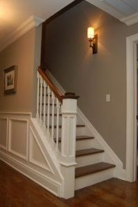 Basement half open staircase, white spindles and rising ...