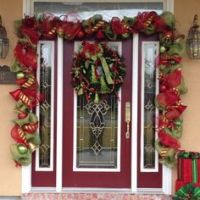 Christmas door garland I made for a customer. She already ...
