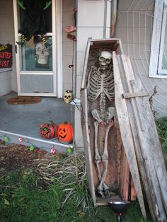Killer paper mache skeleton and wood coffin previously