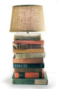 Make a stacked-book table lamp using hardcover books, a ...