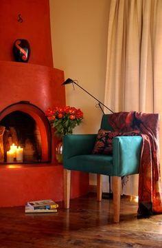 Fireplace photography Santa Fe Style kiva adobe New Mexico terracota Val Isenhower  Santa fe
