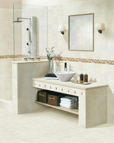 Este bao est pensado en trminos dobles sobre una mesada de cemento bachas rectangulares acompaadas por sendos espejos luminosos con
