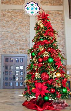 christmas tree decorated in traditional red gold and green with oversized decorations for a big