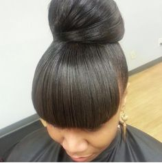 High Bun Hairstyles For Black Women Bun Hairstyles With Bangs 12
