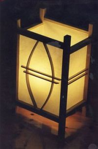 Decorative laser cut wood table lamp. Light is diffused by ...