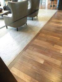 Carpet inlay wood floor bordering 3 feet around room wall ...