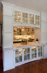 Divider between kitchen and living space. Glass front ...