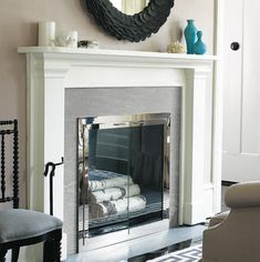 a slate surround and glass doors update a tired fireplace photo david price