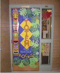 Tiki hut classroom door and wall decor.