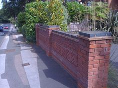 Single Brick Topped With Bricks On Header Landscaping