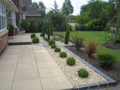 KBHome Beautifully Divided Small Garden Spaces With Gravel Patio