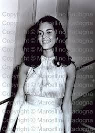 Princess Olimpia Aldobrandini wearing Yves Saint Laurent and a wreath of stephanotis with