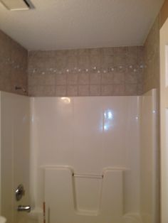 Fiberglass Tub Shower With Tile Surround Above Matching The Floor Tile Bathrooms By GNW