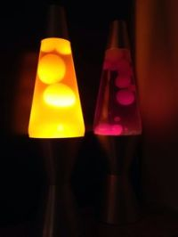 Mega size lava lamp. Clear liquid, red wax, red base ...