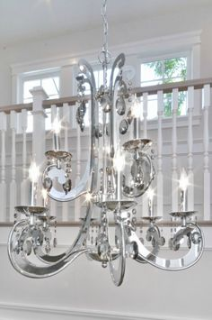 The 9 Light Cyclone Chandelier By Maxim Lighting