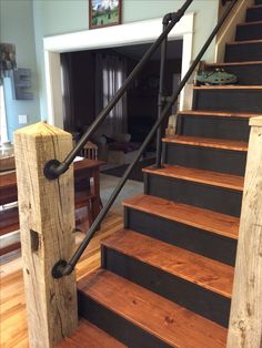 Iron piping handrail lends a rustic industrial look.