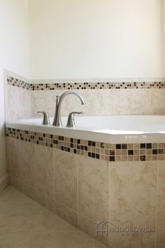 This Beautiful Garden Tub Is Surrounded By Bordeaux Marron Tile