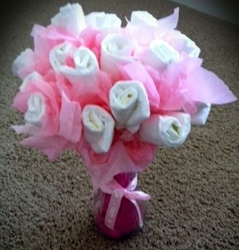How to Make a Diaper Bouquet.  Cute, but I think I'd use onesies and socks i