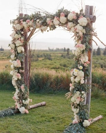 A floral arch anchored this outdoor ceremony–click to see more from this Wyomin