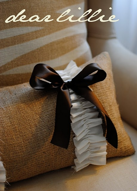 Cute burlap pillows. CHange out the white for antique lace and this would go per