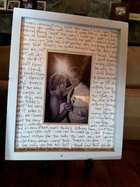 Lyrics of the first dance song surrounding a picture of the first dance!