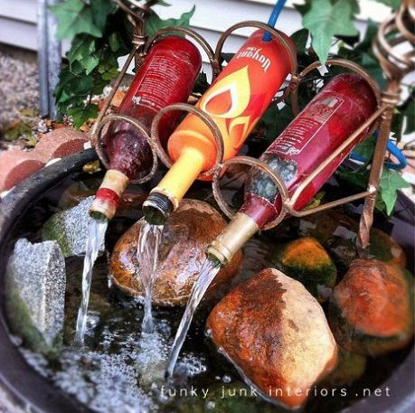 reuse wine bottles for a diy fountain :)