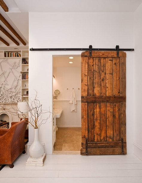 Rustic look – Space saving.  Great use of vintage door! I really like this would