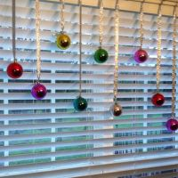 Decorate windows with cheap Christmas balls & ribbon ...