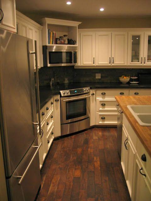 Walnut Hardwood Flooring In White Kitchen With Black