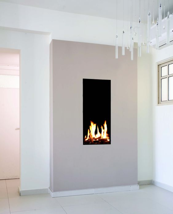 Tall & narrow gas fireplace created by Ortal
