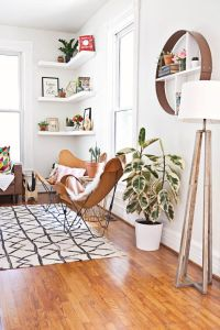floating corner shelves; butterfly chairs; tripod lamp ...