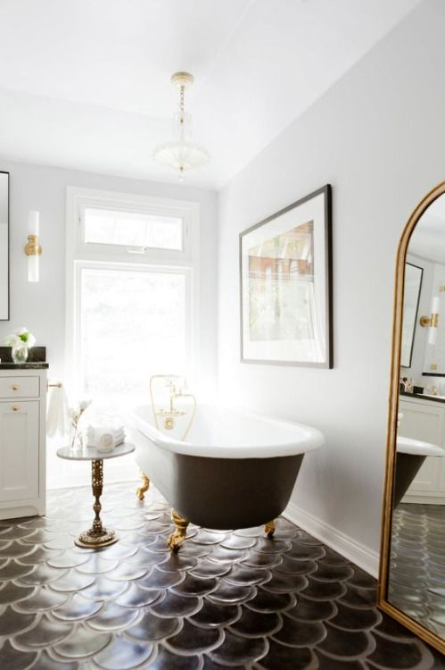 Beautiful bathroom! Nothing better than a claw foot tub with gold and black accents!: