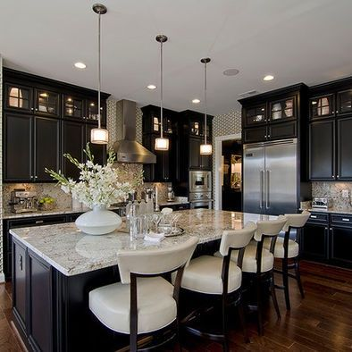 Dark tall cabinets with dark floors and light marble countertops. Simple, crisp and elegant. Love the design.: