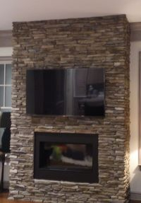 We mounted this TV on a stone wall above a decorative ...