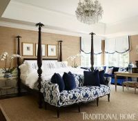 A navy-and-tan palette wraps this master bedroom in ...