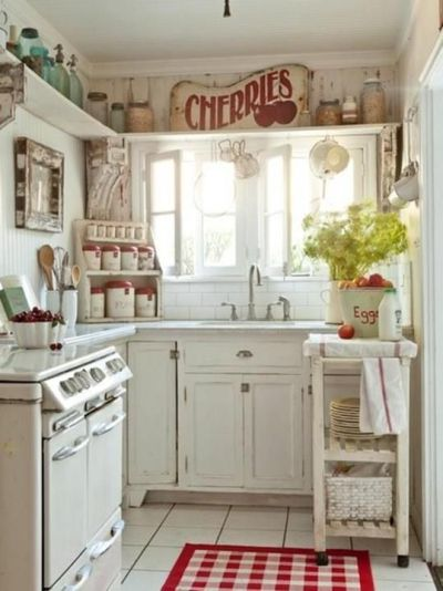 pretty red and white farmhouse kitchen expertly done.: