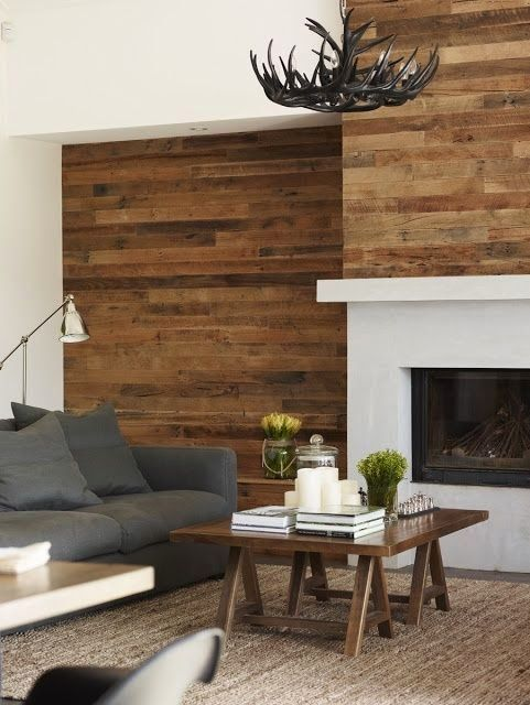 using scrap wood on a wall above fireplace | Facing an existing wall with wood planks in a great DIY project.: