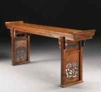 A HUANGHUALI RECESSED-LEG LONG TABLE (QIAOTOUAN) MING ...