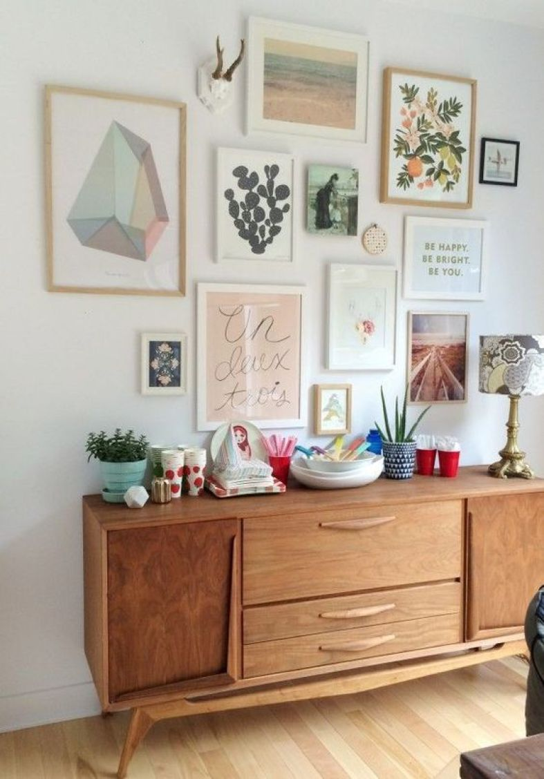 Love this gallery wall with cool colors and mid century furniture
