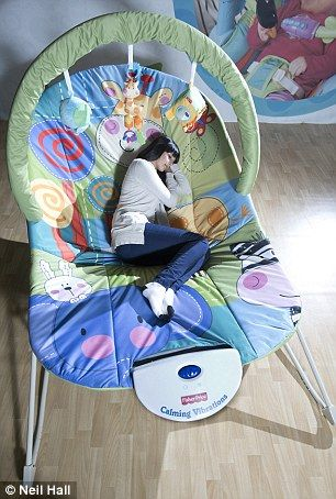 bouncy chairs for babies black office with wheels who's a big baby? huge adult-size chair gives parents the chance to look through their ...